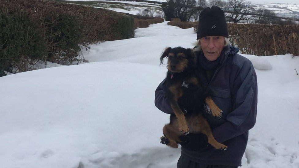 Ian Cole and his dog in the snow