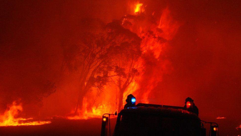 Fire crews battle a blaze in Victoria on 7 February, 2009