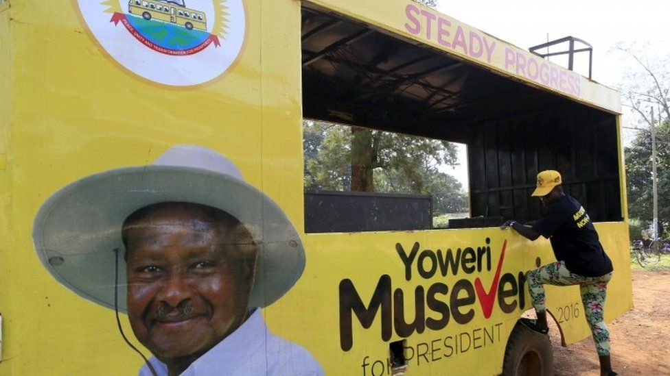 A woman gets off a truck with pictures of National Resistance Movement (NRM) party candidate Yoweri Museveni in Masindi town January 23, 2016 ahead of the February 18 presidential election