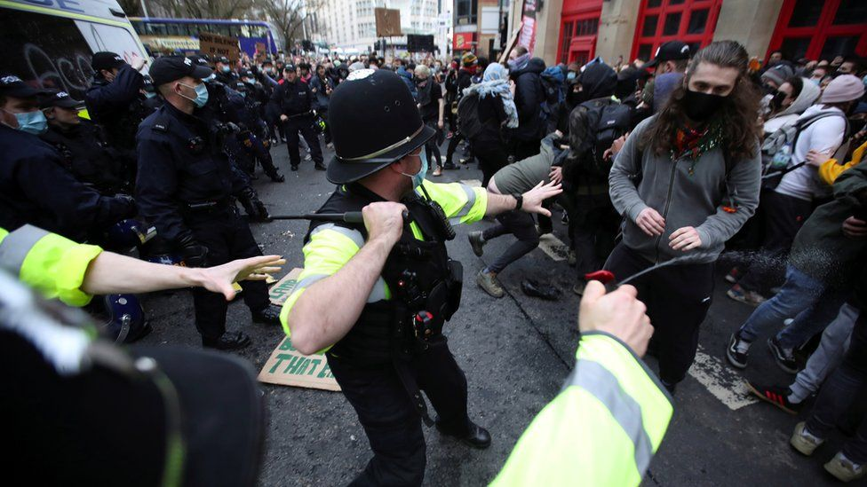 Police with batons