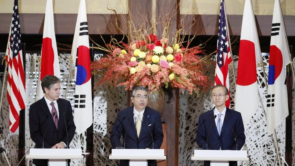 US Deputy Secretary of State Antony Blinken, left, Japanese and South Korean counterparts Shinsuke Sugiyama and Lim Sung-Nam, at a joint press conference in Tokyo, 27 October.