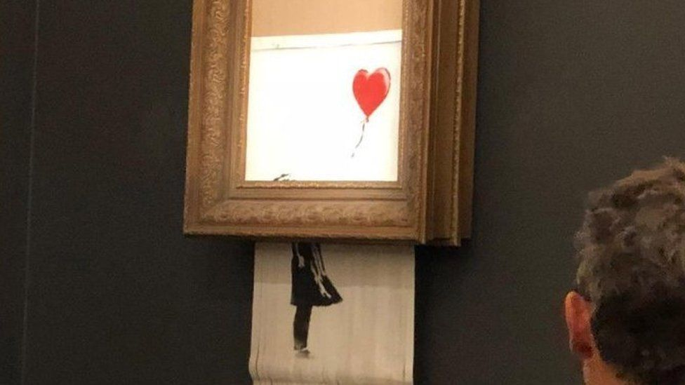 Banksy's Girl With Red Balloon mysteriously shreds after its sale