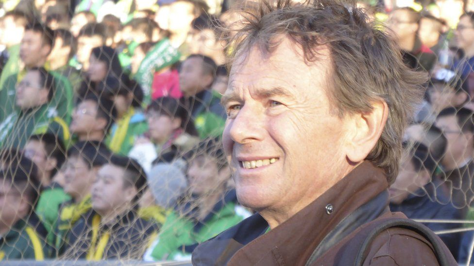 Michael Wood in the crowd at a football match in China