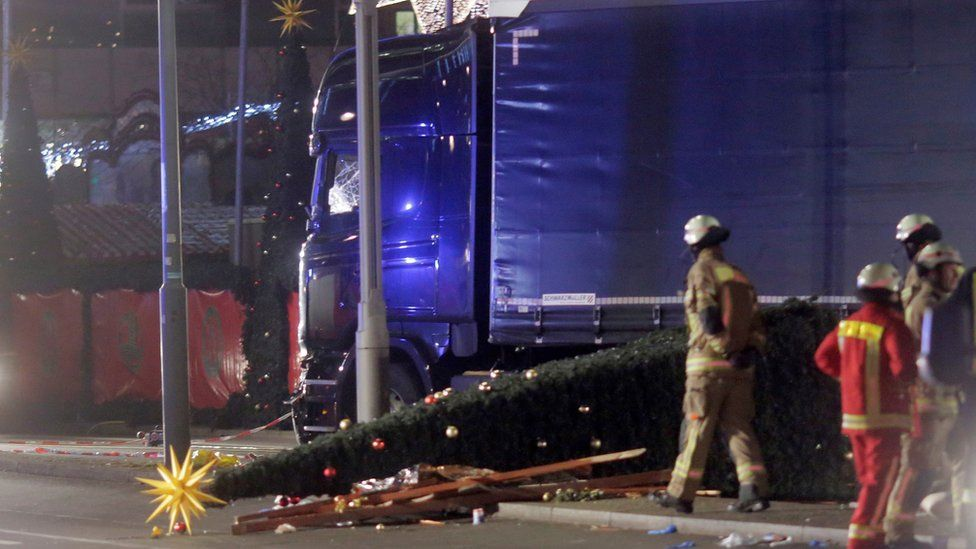 A fallen Christmas tree lies beside the crashed lorry in Berlin, 19 December
