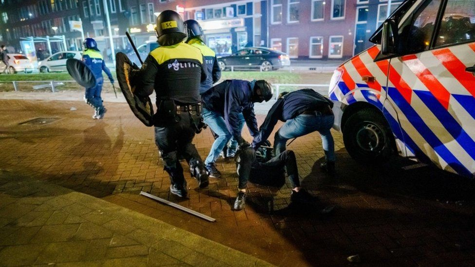 A man is arrested by Police during clashes in Rotterdam, The Netherlands