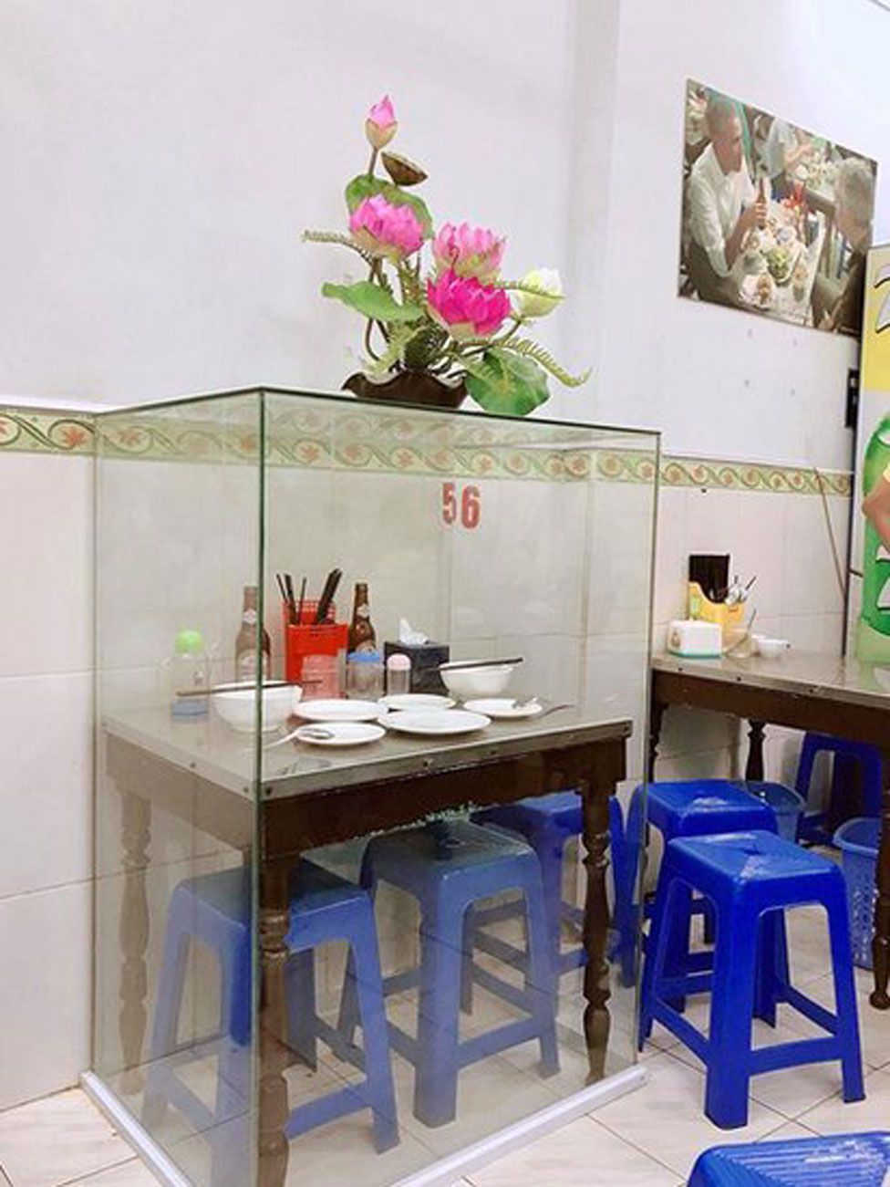 The table where Anthony Bourdain and Barack Obama had their famous meal in Hanoi has been put in a glass case for posterity