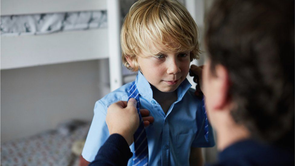 Child being dressed for school
