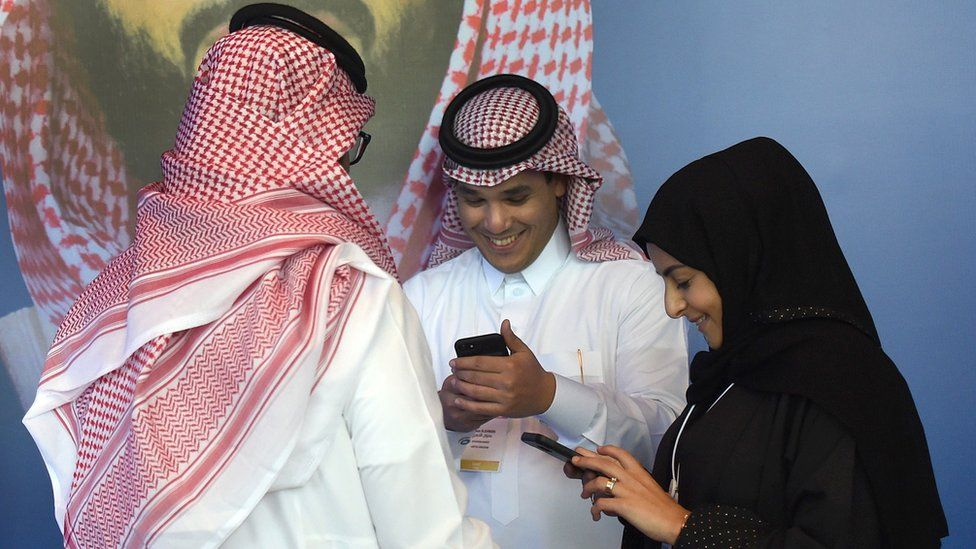 People using mobile phones in Saudi Arabia