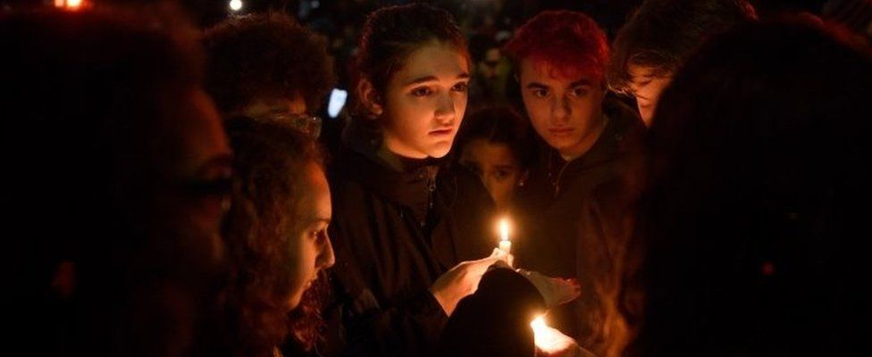 People at a vigil in Pittsburgh's Squirrel Hill