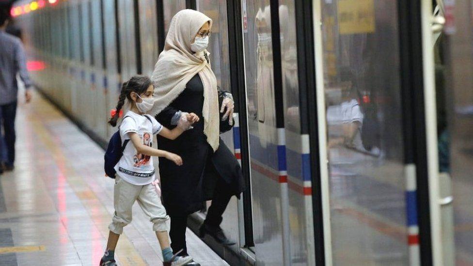 Woman and child on Tehran metro