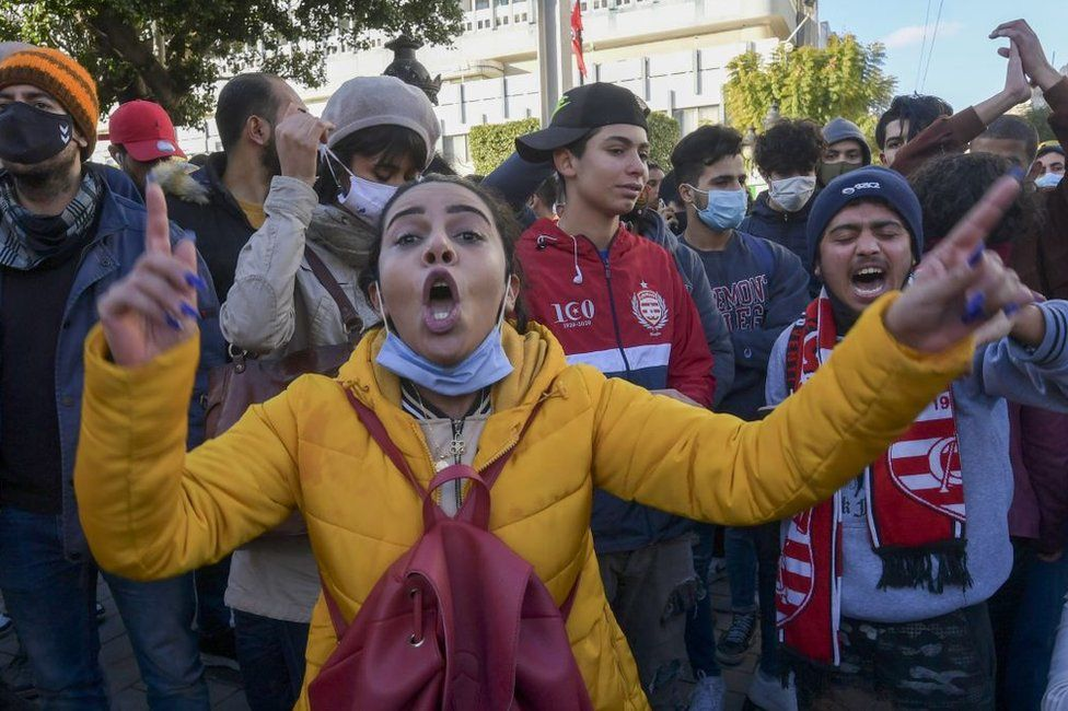 Tunisian protesters shout slogans during an anti-government demonstration on the Habib Bourguiba avenue in the capital Tunis, on January 19, 2021.