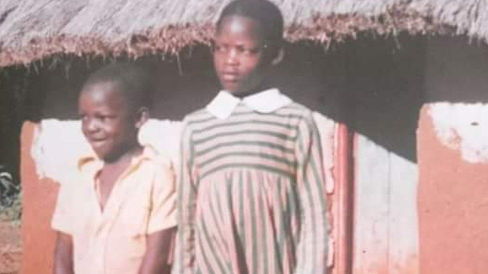 Two young children standing next to each other