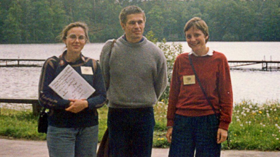 A photo taken in 1989 in the northern Polish city of Bachotek shows (from L) now quantum chemistry professor Malgorzata Jeziorska, Joachim Sauer, the husband of German Chancellor Angela Merkel, and the German leader during summer school at a university for chemistry students.