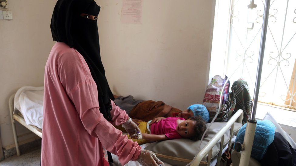 A Yemeni child suspected of having been infected by cholera is treated at a hospital in Hudaydah, 26 May 2018