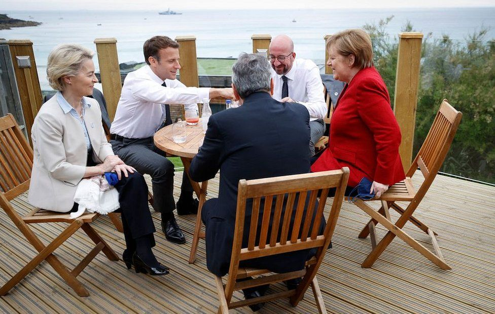 Leaders having a drink by the sea