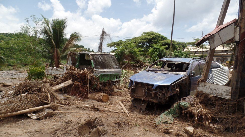 Damaged cars in Ronald Jno Baptiste's car repair business in Jimmit