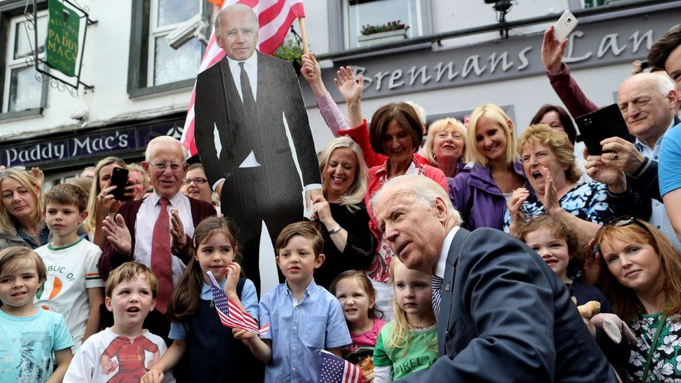 Joe Biden posing for a photo with residents in Ballina in 2016