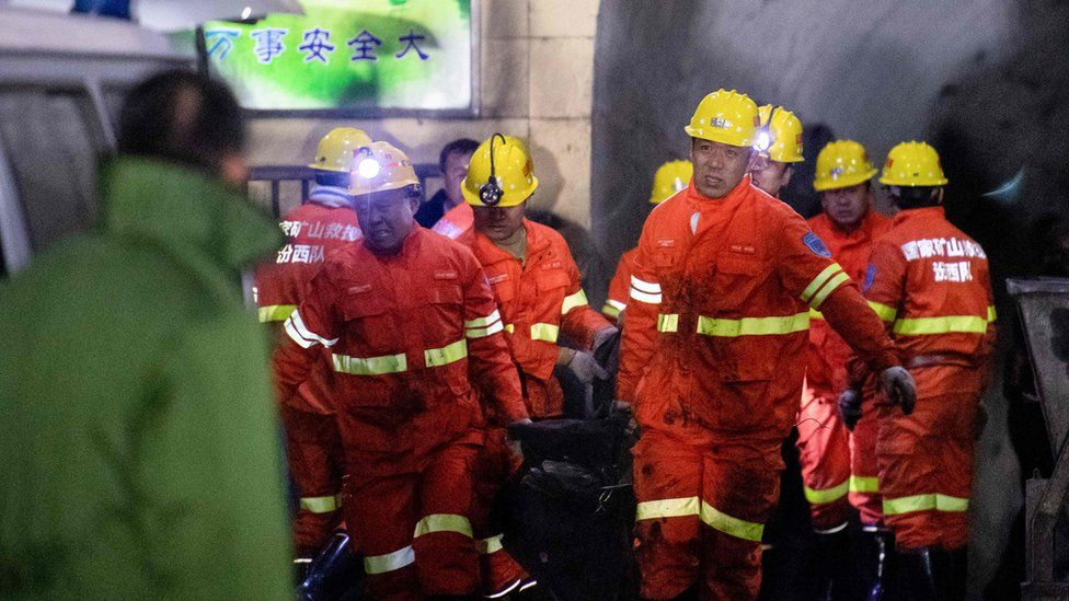 Rescuers carry a victim at the site of a coal mine explosion in Pingyao, early on November 19, 2019