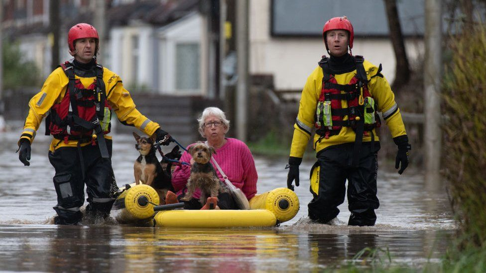 A woman is rescued with her dogs in Nantgarw