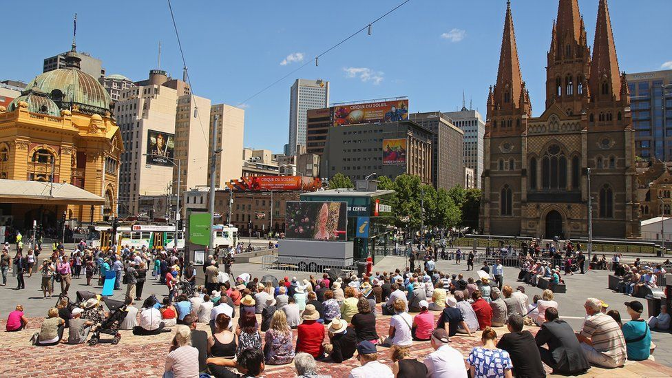 A crowd of people in Federation Square in Melbourne