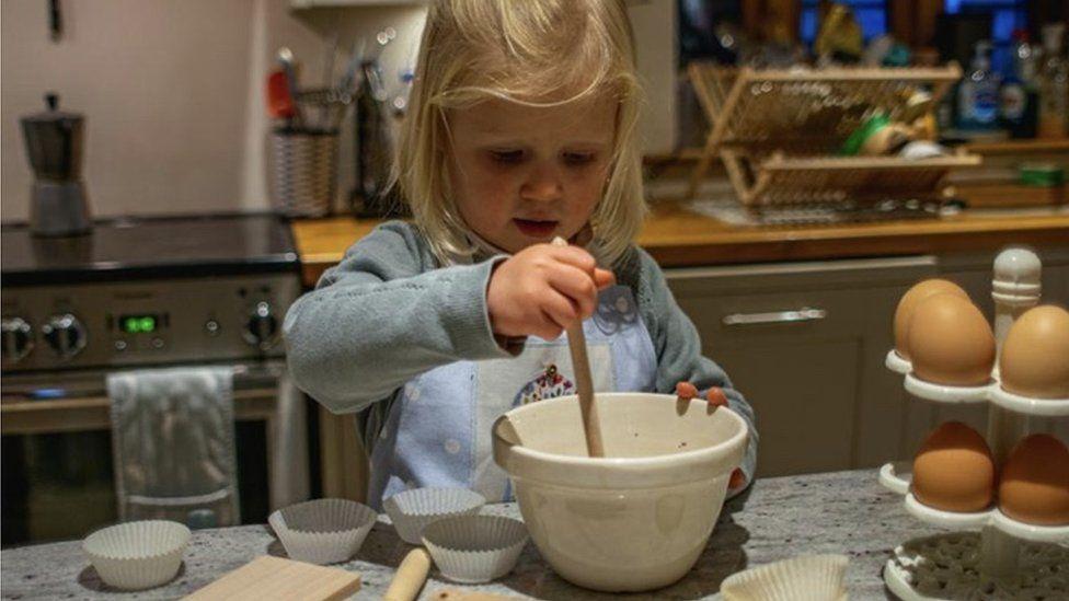 Katherine's daughter Beatrix baking