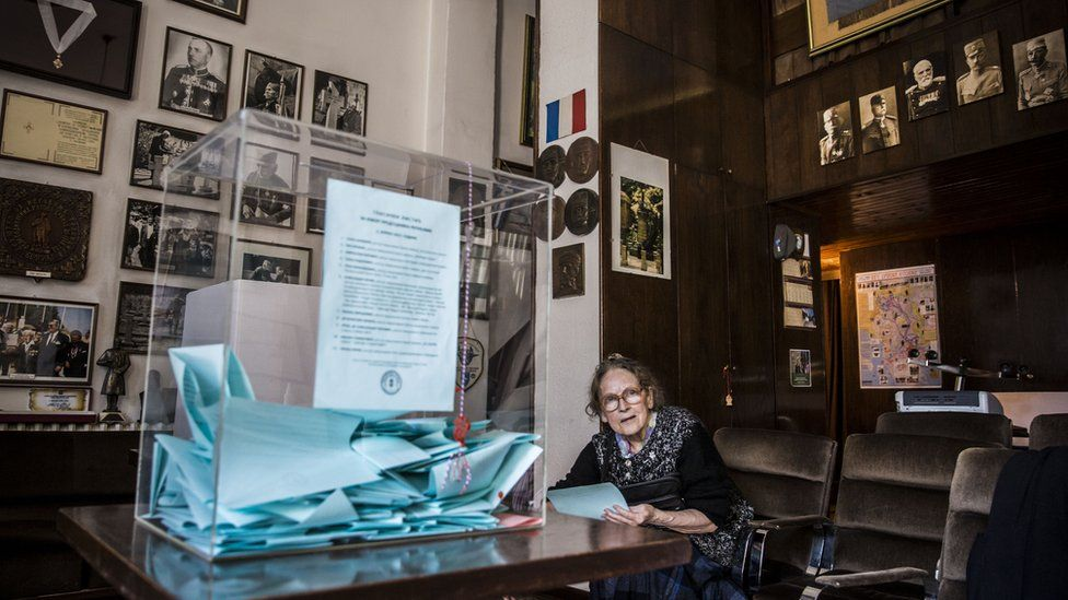 A woman prepares to cast her ballot at a polling station, in Belgrade, on April 2, 2017.