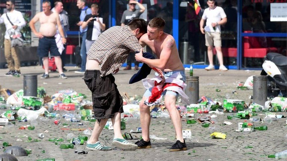 England fans help each other after tear gas use in Marseille
