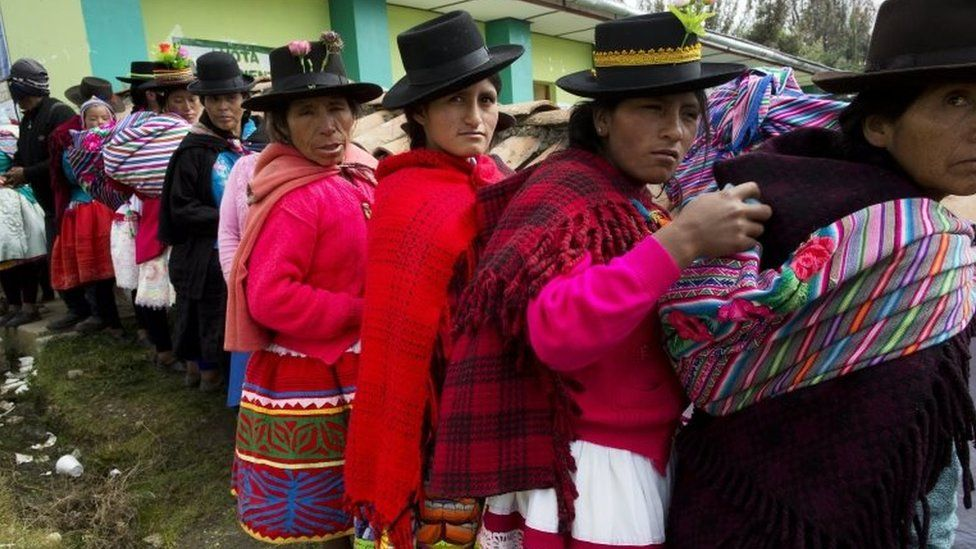 Quechua Indian women stand in line to vote in the general elections, in Uchuraccay, Peru, Sunday, April 10, 2016.