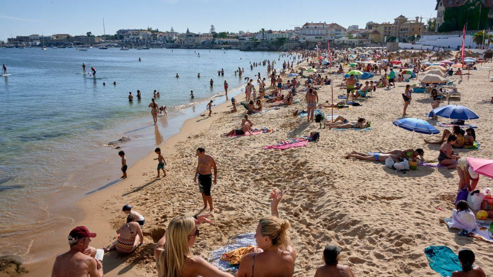 Beachgoers in Cascais, Portugal last summer