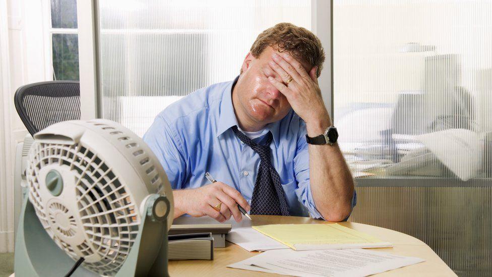 Man sweltering