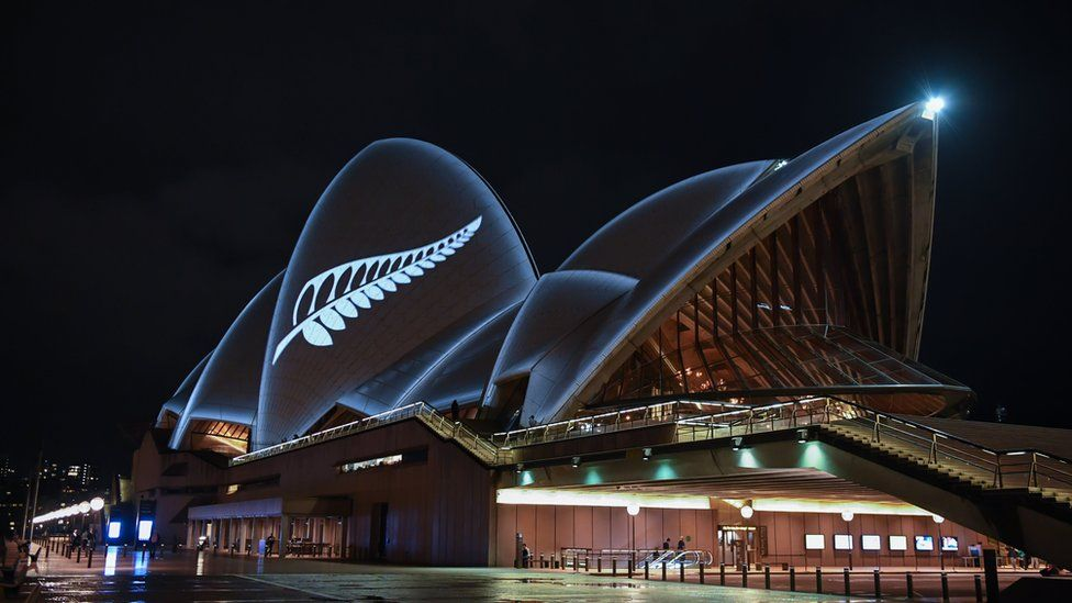 A silver fern is projected onto the sails of the Opera House in commemoration of the victims of the Christchurch massacre on March 16, 2019