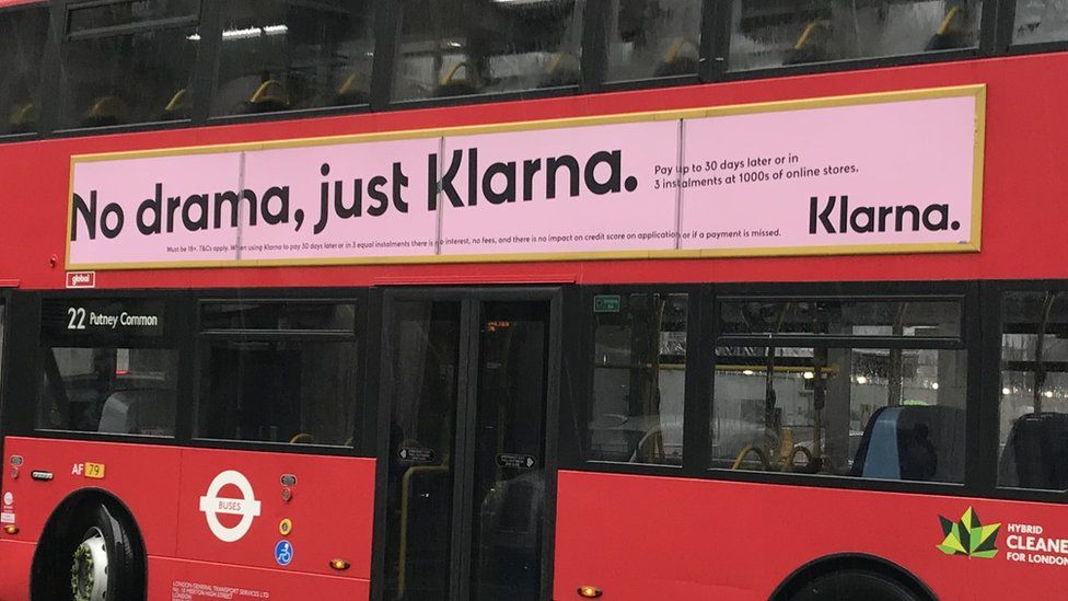 Klarna advert on the side of a bus