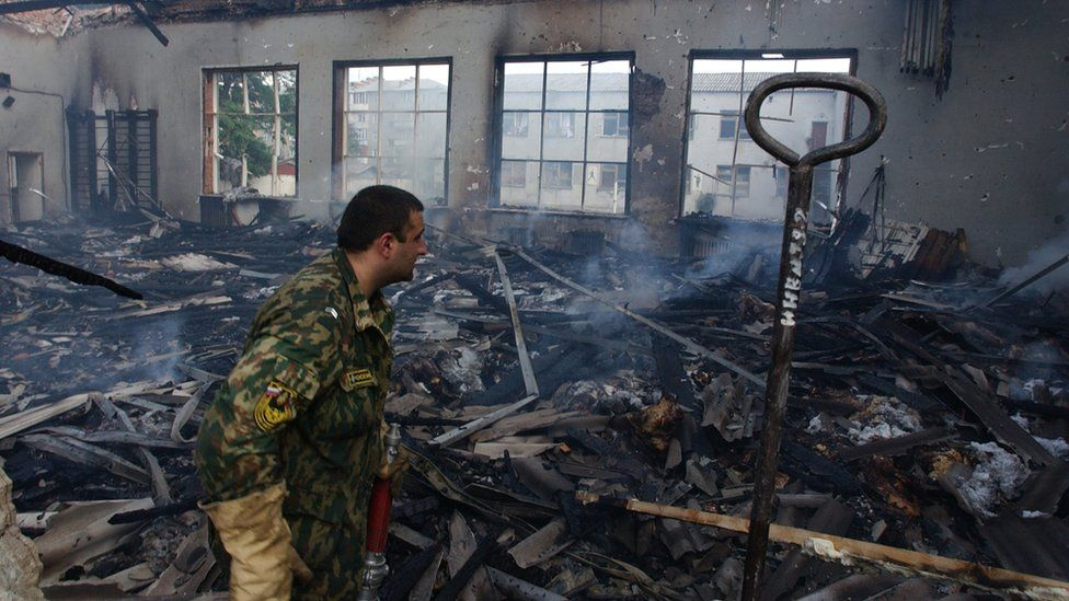 A fireman investigates a gym during the rescue operation at Beslan school, North Ossetia