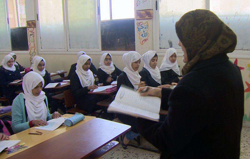Teacher in school room