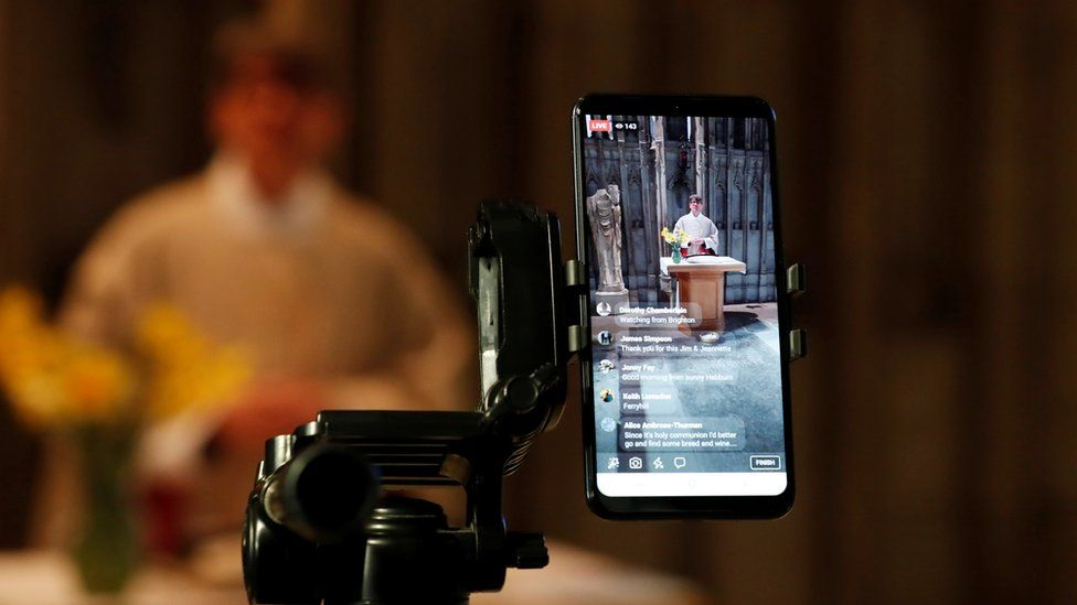 Very reverend Andrew Tremlett, conducts Sunday holy communion live on social media in shrine of St Cuthbert as the spread of the coronavirus disease (COVID-19) continues. Durham,