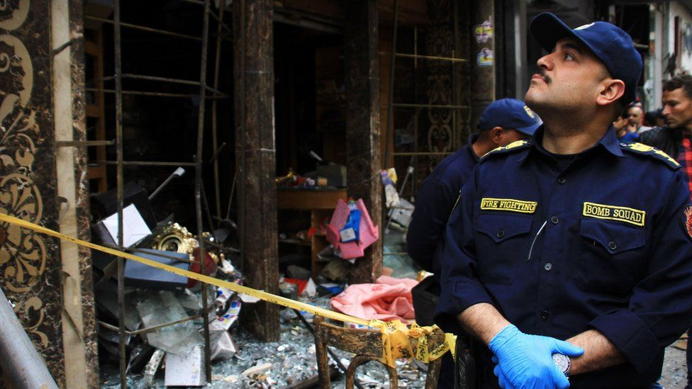 Security personnel investigate the scene of a bomb explosion outside the Saint Mark's Coptic Cathedral in Alexandria