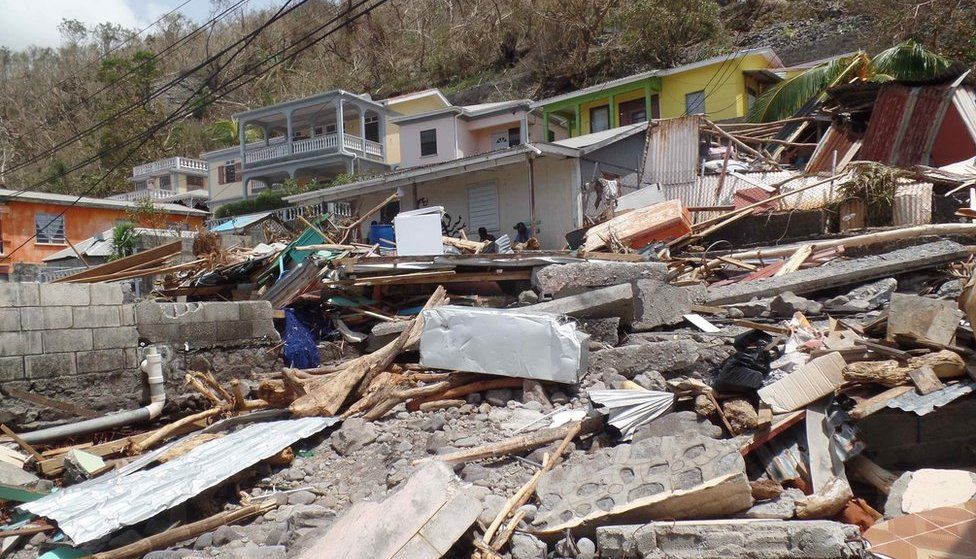 The body of Lucy Thomas, 74, is believed to be under this rubble in Scott's Head, Dominica