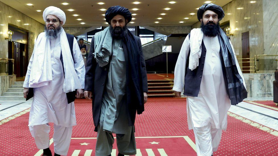 Taliban delegation headed by Abdul Ghani Baradar (C), the groups deputy leader, are seen leaving the hotel after attending the meeting on Afghan peace with the participation of delegations from Russia, China, the US, Pakistan in March 2021