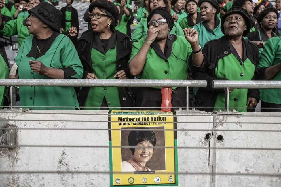 Mourners sing and dance during the official funeral ceremony of late Anti-apartheid icon Winnie Madizikela-Mandela at the Orlando Stadium in Soweto on April 14, 2018 in Johannesburg, South Africa. South Africa will lay to rest anti-apartheid icon and Nelson Mandela's former wife Winnie Mandela with full state honours at a stadium funeral in Soweto on April 14. The ceremony will conclude 10 days of national mourning during which time thousands of South Africans have paid tribute to the 'Mother of the Nation' at her Soweto home and elsewhere.