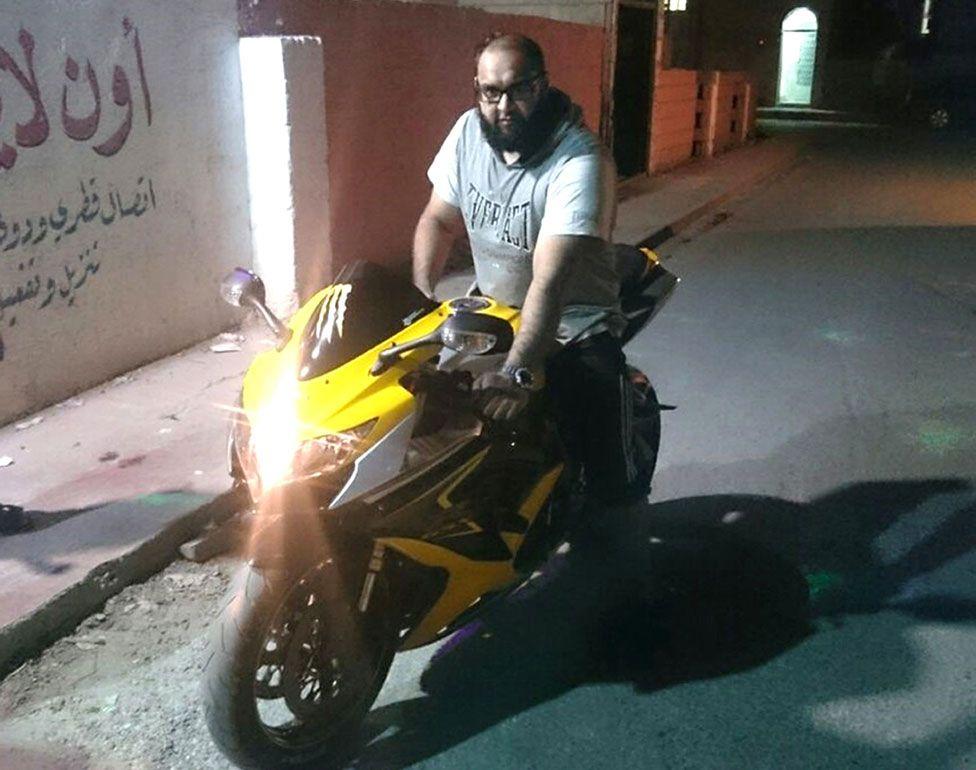 Hussain on a motorbike