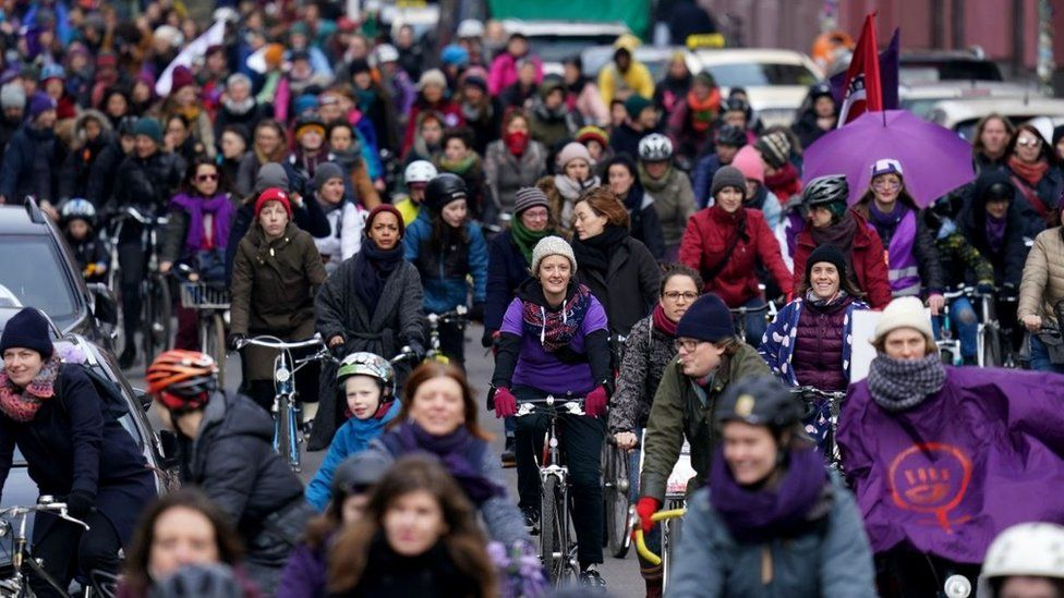 "Women riding bicycles participate in the ""Purple Ride"" feminist women's bicycle protest on International Women's Day in Berlin, Germany, 8 March 2020"