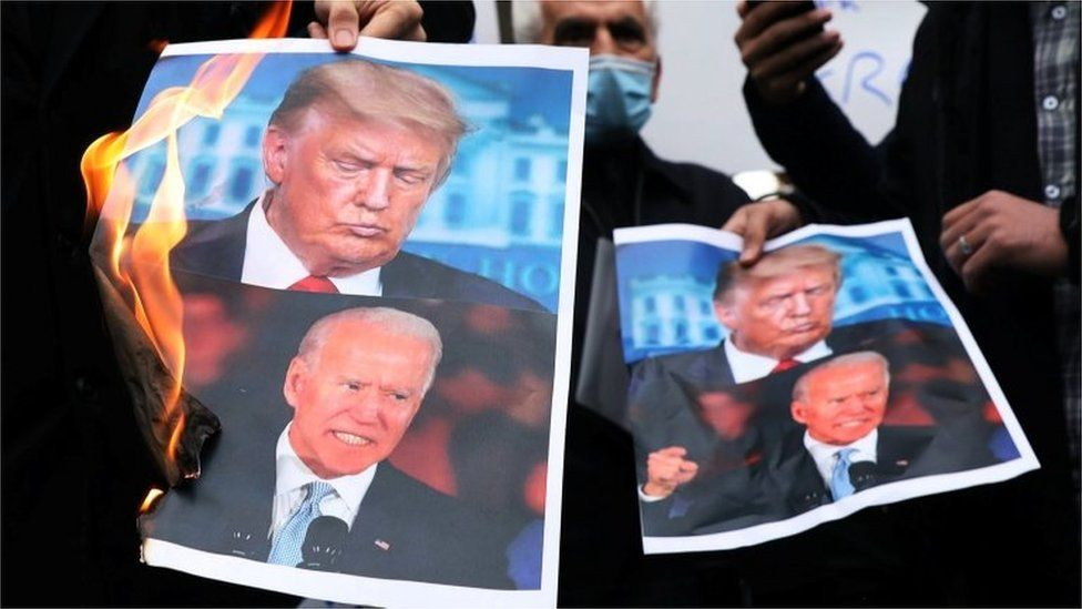 Pictures of Donald Trump and Joe Biden are burned at a protest in Tehran against the killing of top nuclear scientist Mohsen Fakhrizadeh (Nov 2020)