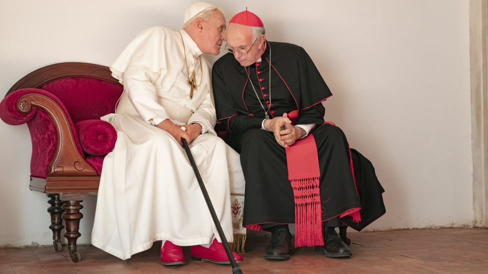 Hopkins and Pryce as the two popes sitting together