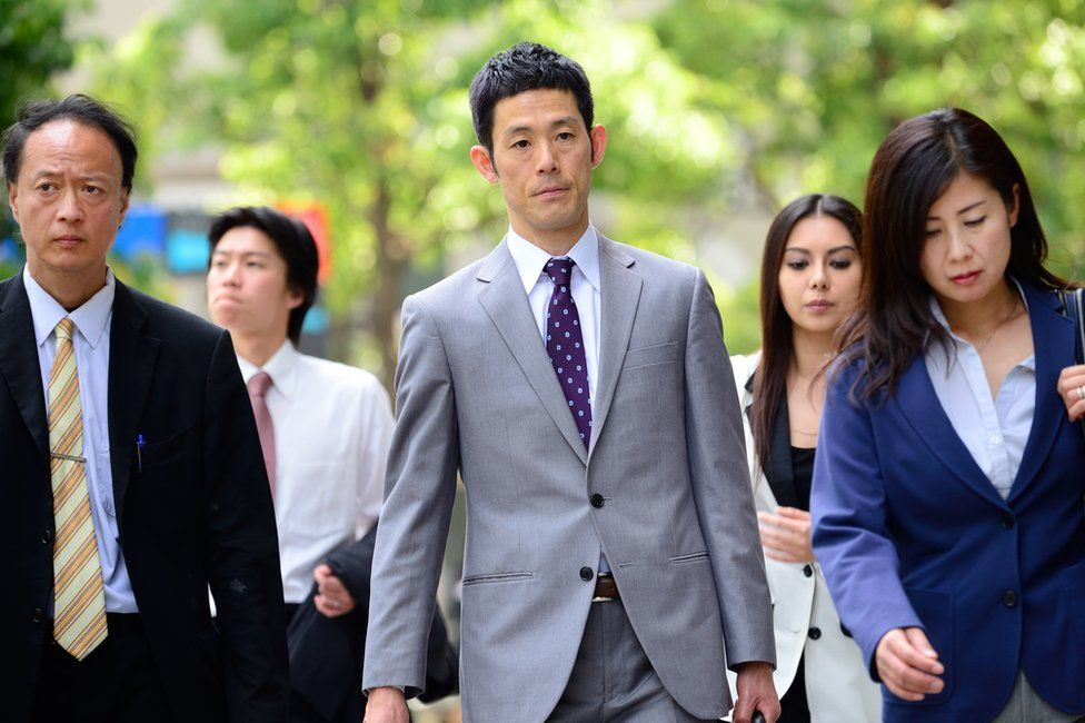 Japanese men and women walking down the street