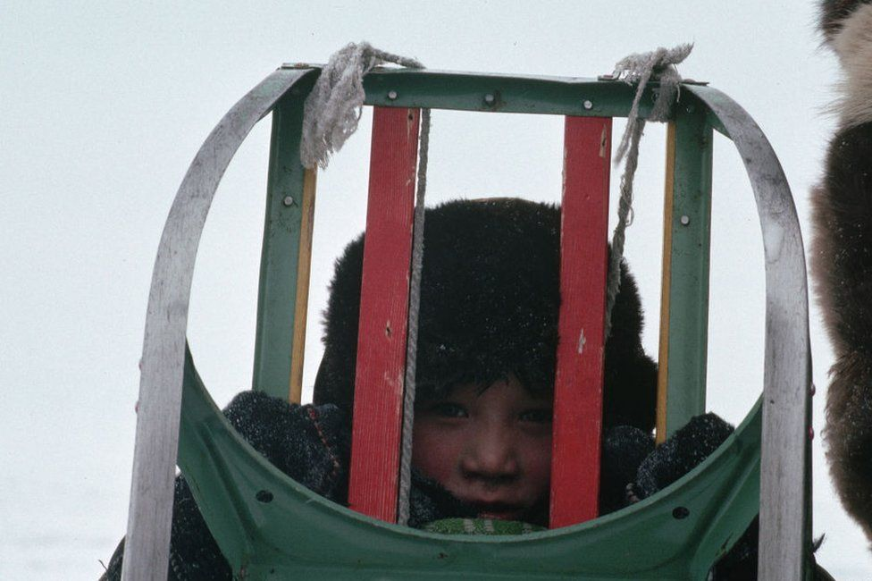 A young Chukchi child with a sledge