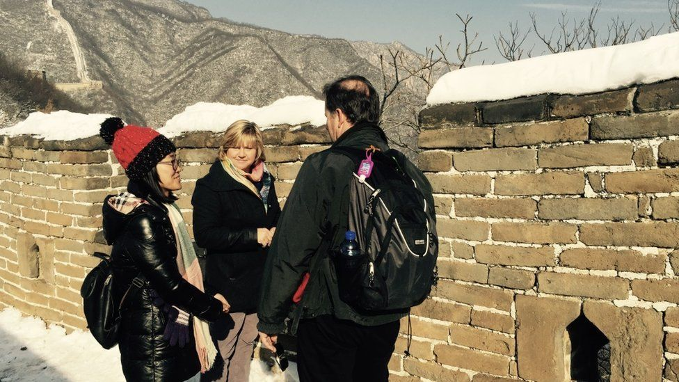 Chinese tour guide Catherine Lu taking people around the Great Wall of China