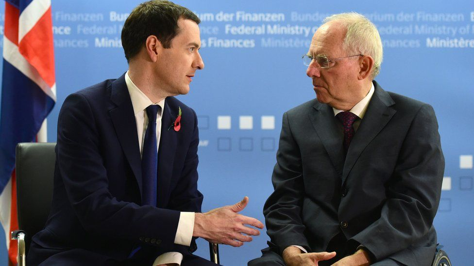 Wolfgang Schauble (R) talks with British Chancellor of the Exchequer George Osborne