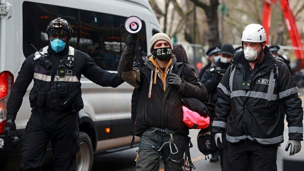 Activist led away by officers