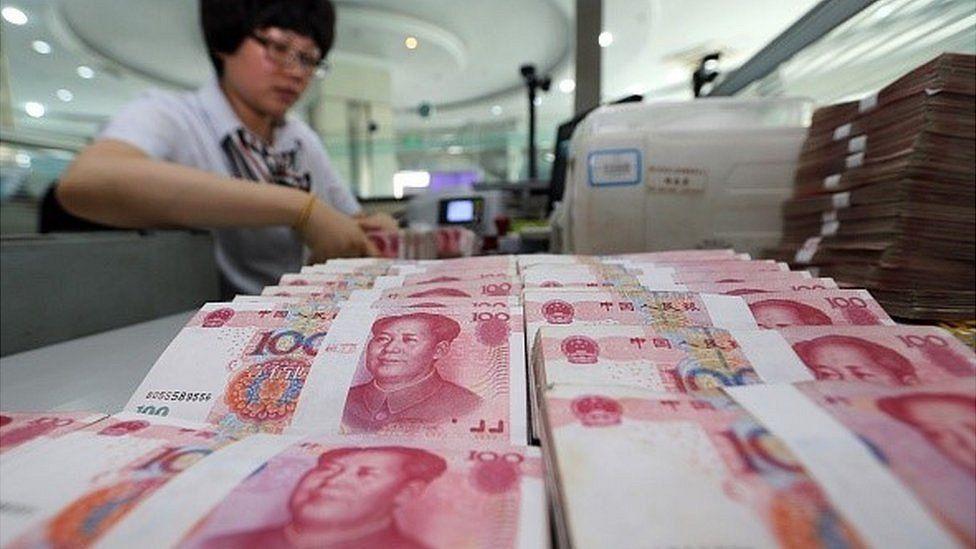 Woman counting yuan