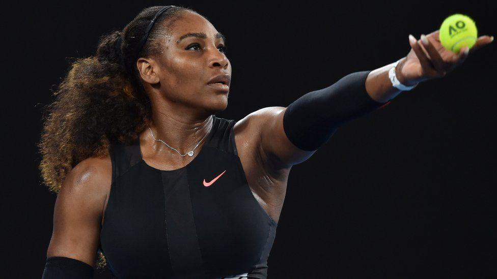 Serena Williams serving during a 2017 Australian Open match